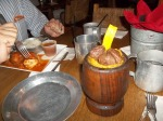 Eating and drinking from tin. Dinner always included plantains, which is underneath the steak